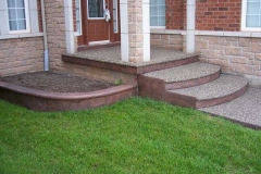 Exposed Front Walk with Bullnose and Stamped Faces and Garden Curb.