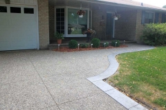 Exposed Driveway, Front walk No colour Added. Stamped Yorkstone Border in Winter Gray.