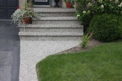 Exposed Porch, Curb, Front Walk, Steps with Bullnose.