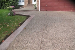 Exposed Driveway with Flat Stamped Curbs