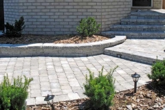 Tumbled Pavers with lights in steps.