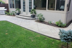 #49 York Stone Stamped Concrete with Rock Texture Bullnose.