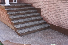 Exposed with Bullnose and Stamped Face of Steps