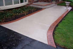 Broom Finish with Stamped Border.