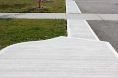 Broom Finish Regular Concrete Front walk with Curbs.