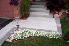 Broom Finish Front Walkway with Flagstone Border.